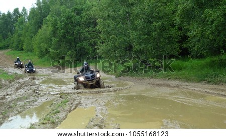 Man riding ATV in mud Stock photo ©