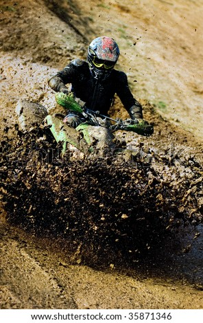 Man riding ATV in muddy conditions
