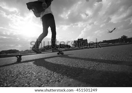 Man riding by longboard for the bird. Black and white concept. #451501249