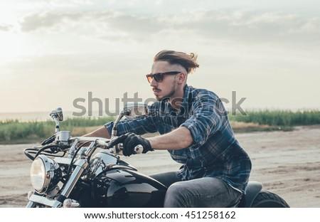 man riding motorcycle #451258162