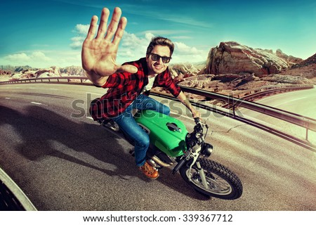 man riding motorcycle in ...