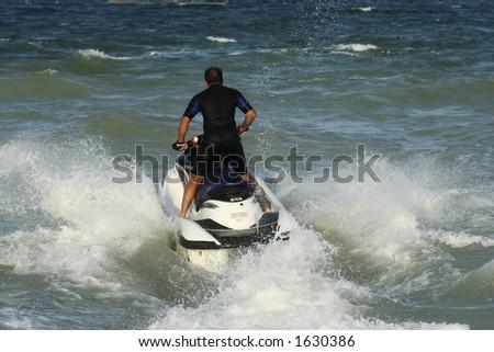 man riding skijet