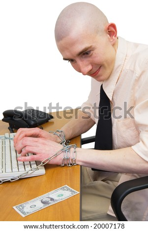 Man riveted by chain to keyboard with longing looks at dollar