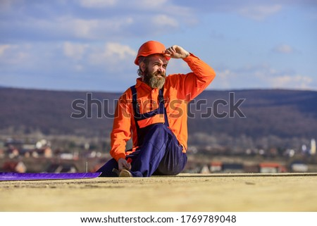 Man roofing surface. Estimate materials requirements for projects. Install roofing materials. Heat insulation. Professional master repair roof. Flat roof installation. Roofer constructing new roof.