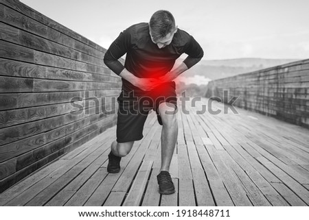 Man runner having stomach side stitch or cramps during training. Athlete suffering from side pain after jogging or running. Stock photo ©
