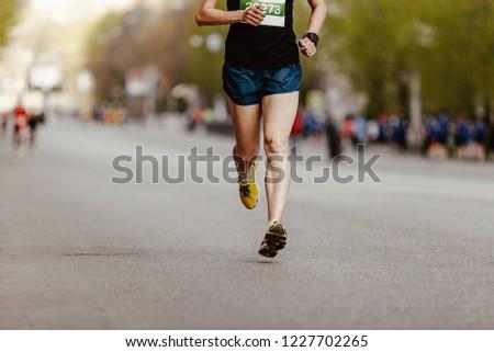 man runner run race on city with running watch on hand #1227702265