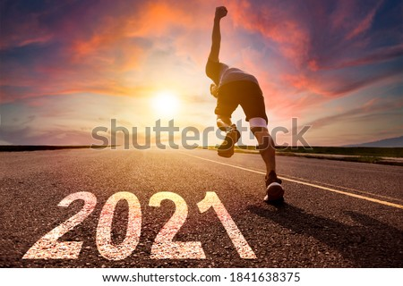 man running and sprinting on road with 2021 new year concept Сток-фото ©