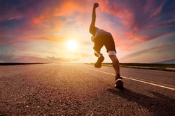 man running and sprinting on road with sunset background