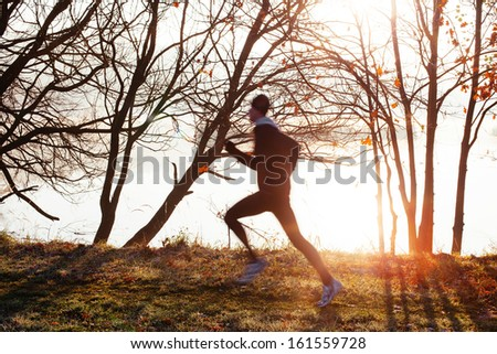 Man running at morning during sunrise