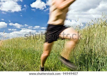 Man running cross country on trail, sport and fitness outdoors - stock photo