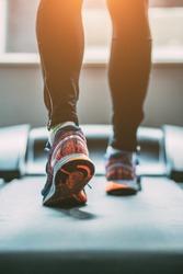 Man running in a gym on a treadmill