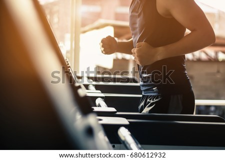 man running in a modern gym on...