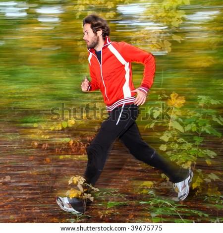 Man running in autumn forest.
