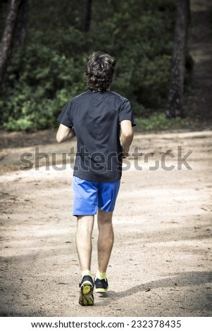 Man running in the park, seen from behind