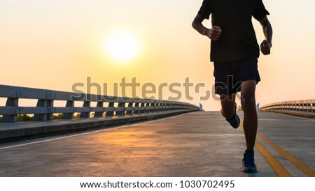 Man running jogging on bridge road. Health activities, Exercise by runner.  #1030702495