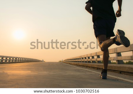 Man running jogging on bridge road. Health activities, Exercise by runner.