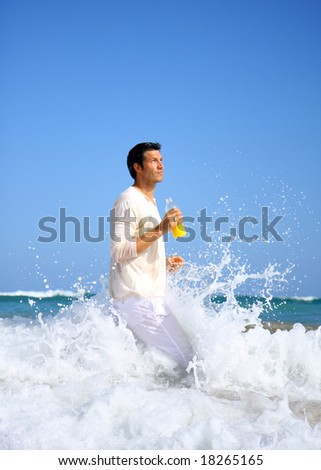 Man running ocean waves with a lot of water drops
