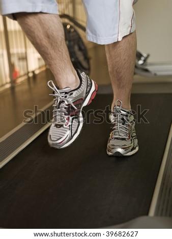 Man running on a treadmill in a healthclub