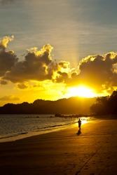 Man running on beach at evening