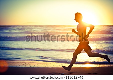 Man running on the beach at sunset - female version in portfolio