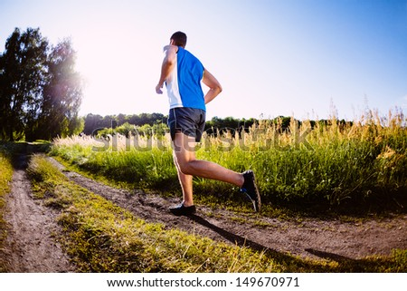Man running outdoors during sunset