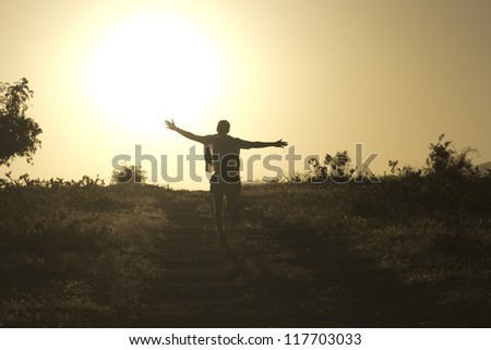 Man runs straight to the setting sun
