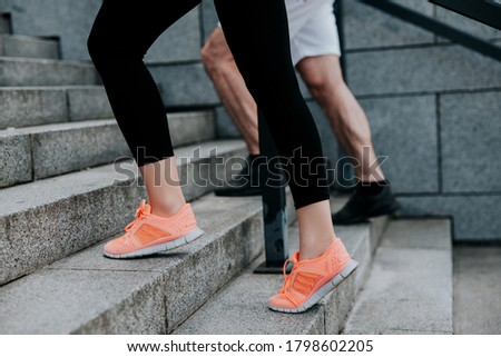man's and woman's feet in sportshoes doing workout on the street, climbing up the stairs, healthy fit lifestyle Stockfoto ©