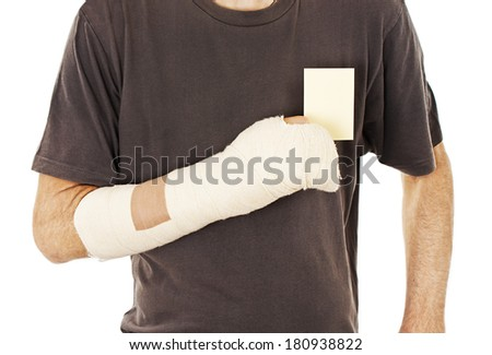 Man's arm in cast holding a blank card. Isolated on white background