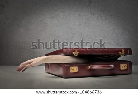 Man's arm poking out from a briefcase