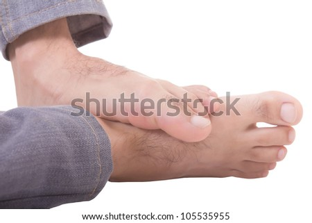 man's feet isolated on a white background