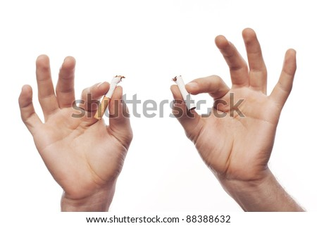 Man's hand crushing cigarette