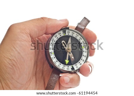 Man's hand holding a compass. Isolated on white