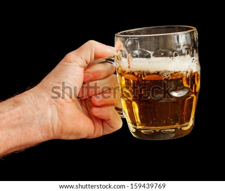 Man's Hand holding a Glass of Beer isolated on black