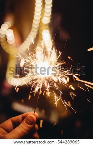 man's hand holding a sparkler #544289065