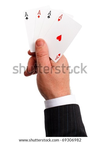 Man's hand holding a trump, the four aces