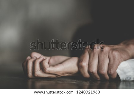 Man's hand holding a woman hand for rape and sexual abuse concept, Wound domestic violence rape, concept photo of sexual assault, International Women's Day