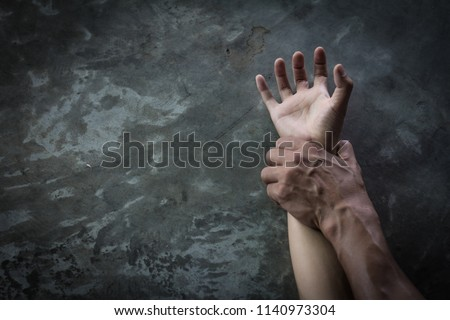 man's hand holding a woman hand,  sexual abuse and rape concept, anti-trafficking and stopping violence against women,