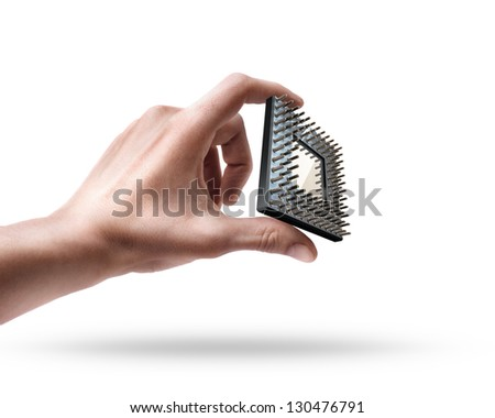 Man's hand holding CPU chip isolated on white background