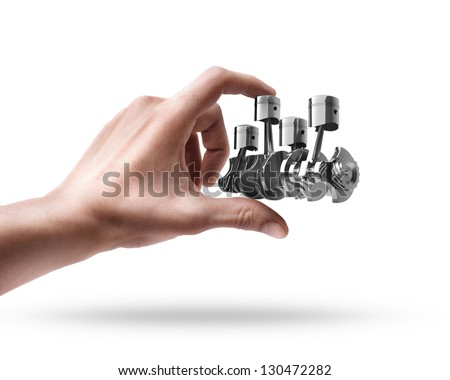 Man's hand holding Engine pistons isolated on white background