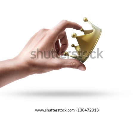 Man's hand holding golden crown isolated on white background