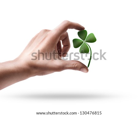 Man's hand holding green clover  isolated on white background