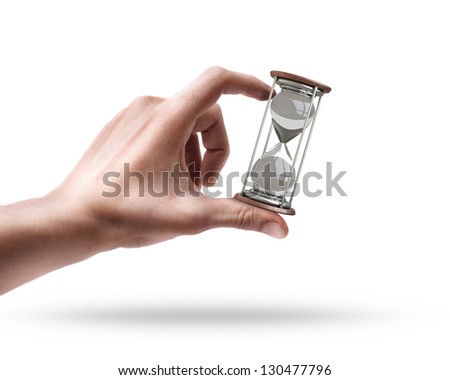 Man's hand holding hourglass isolated on white background