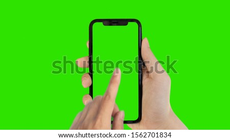 man's hand holding phone a mobile telephone with a vertical green screen in tram chroma key smartphone technology cell phone touch message display hand with luma white and black key stock photo