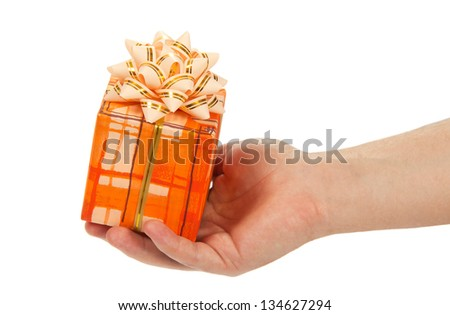 Man's hand holding the gift box, isolated on white