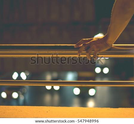man's hand holding the rail...