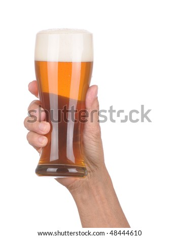 Man's Hand Holding up a Glass of Foamy Beer over a white background