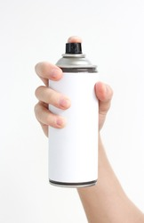 Man's hand holds a spray of black paint. Isolated on a white background