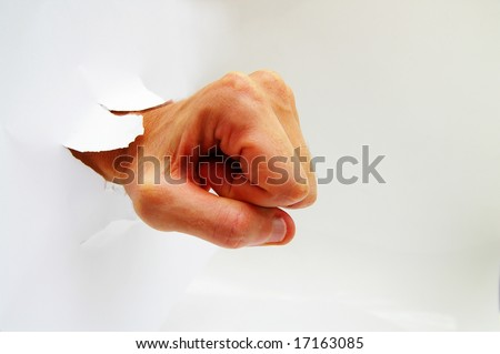 stock-photo-man-s-hand-in-a-fist-punchin