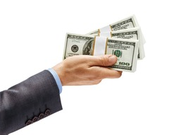 Man's hand in suit giving bundles of money isolated on white background. High resolution product. Close up
