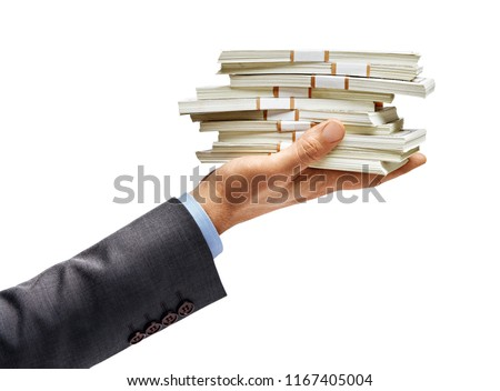 Man's hand in suit holding bundles of money isolated on white background. High resolution product. Close up